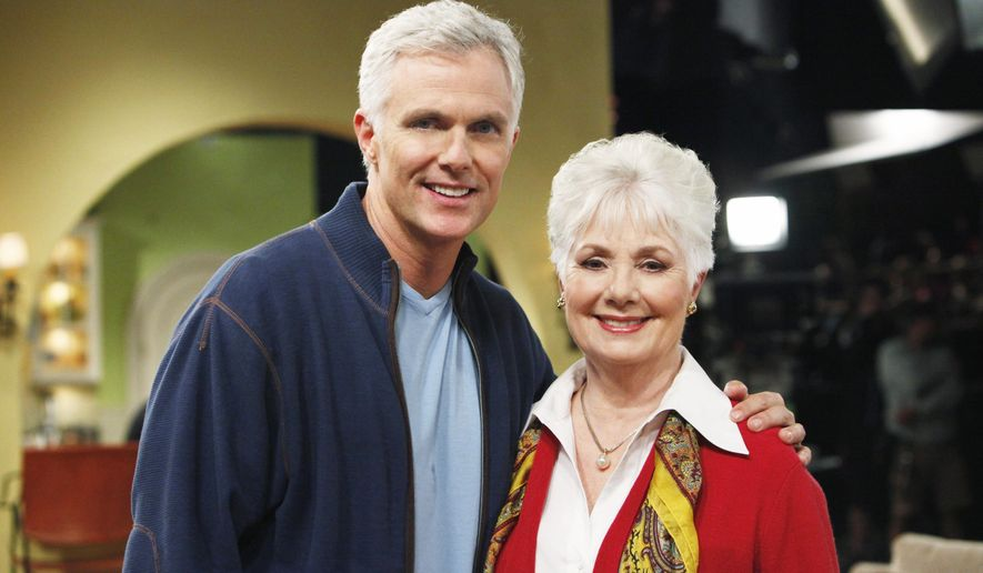 "This undated image released by David Gersten & Associates shows Patrick Cassidy, left, with his mother, actress-singer Shirley Jones. Jones is about to hit the road in a concert version of ""The Music Man."" Jones, who starred in the 1957 classic film version, will start a seven-state tour this month with Cassidy playing con man Harold Hill. The two have a long history with the musical: She was pregnant with Patrick while the film was being shot.  (AP Photo/David Gersten & Associates)"