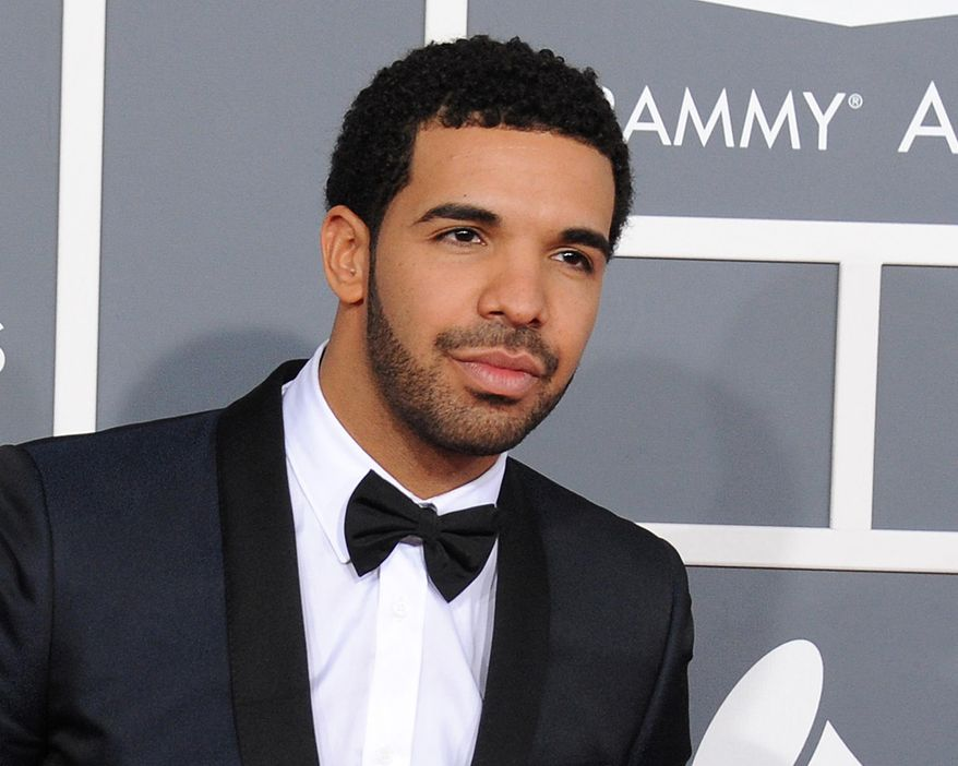 FILE - In this Feb. 10, 2013 file photo, rapper Drake appears at the 55th annual Grammy Awards in Los Angeles. For the first time, Drake tops nominees for the BET Hip-Hop Awards. In a statement to The Associated Press, BET said Thursday that Drake received the most nominations with eight for the ninth annual awards show. It airs Oct. 14.  (Photo by Jordan Strauss/Invision/AP, File)