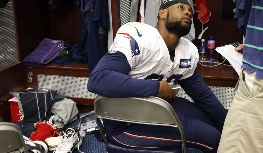 New England Patriots running back Stevan Ridley speaks to a reporter in the locker room after team practice in Foxborough, Mass., Wednesday, Sept. 3, 2014. The Patriots are preparing for their opening NFL football game against the Miami Dolphins on Sunday in Miami. (AP Photo/Elise Amendola)