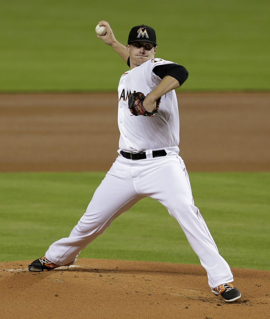 Miami Marlins' Tom Koehler pitches against the New York Mets in the first inning of a baseball game in Miami, Wednesday, Sept. 3, 2014. (AP Photo/Alan Diaz)