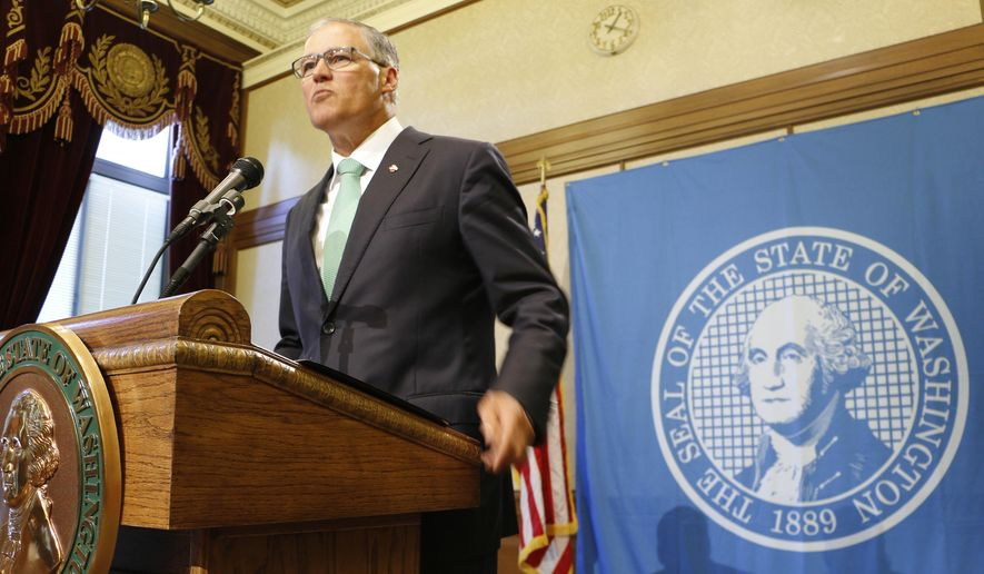 Washington state Gov. Jay Inslee talks to reporters about how the state needs to address education funding, on Thursday, Sept. 4, 2014, in Olympia, Wash. The state Supreme Court this week ordered lawmakers to explain why they haven't followed its orders to fix the way Washington pays for public education. (AP Photo/Rachel La Corte)