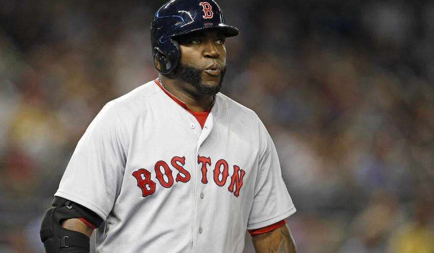 Boston Red Sox designated hitter David Ortiz reacts after flying out to New York Yankees center fielder Brett Gardner in the Red Sox's 5-1 loss in a baseball game at Yankee Stadium in New York, Wednesday, Sept. 3, 2014. (AP Photo/Kathy Willens)