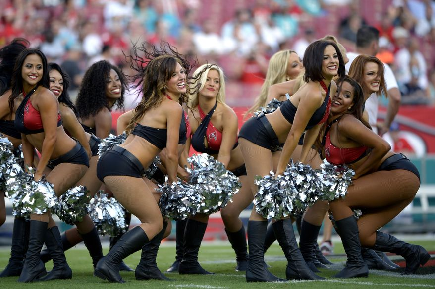 10. TAMPA BAY BUCCANEERS CHEERLEADERS - Tampa Bay Buccaneers cheerleaders perform prior to an NFL preseason football game against the Miami Dolphins in Tampa, Fla., Saturday, Aug. 16, 2014.(AP Photo/Phelan M. Ebenhack)