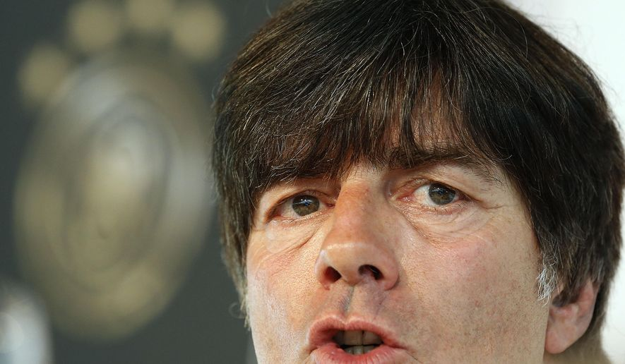 German soccer team head coach Joachim Loew addresses the media during a press conference ahead of the friendly soccer match between Germany and Argentina on Wednesday in Duesseldorf, Germany, Tuesday, Sept. 2, 2014. Loew announced that Bastian Schweinsteiger has been named Germany captain to replace the retired Philipp Lahm.  The 30-year-old Schweinsteiger, who will miss Germany's next two games because of a lingering knee injury, will take over from his Bayern Munich teammate, who is also 30 but stepped back from international soccer after winning the World Cup.  (AP Photo/Frank Augstein)