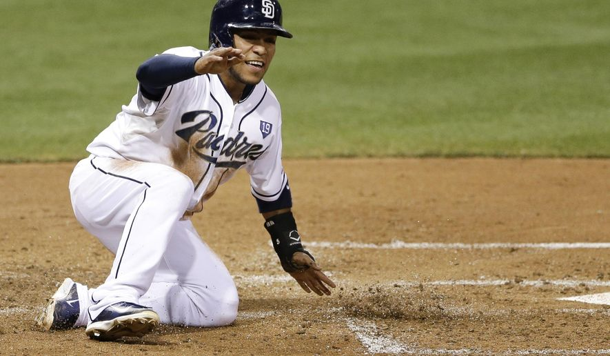 San Diego Padres' Alexi Amarista reacts after scoring on a double by Seth Smith against the Arizona Diamondbacks during the third inning of a baseball game Wednesday, Sept. 3, 2014, in San Diego. (AP Photo/Gregory Bull)