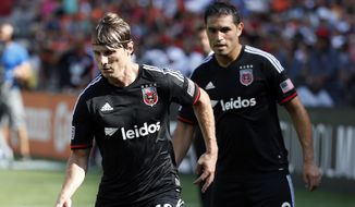 D.C. United forwards Chris Rolfe (18) and Fabian Espindola (9) in action during the second half of an MLS soccer match against the New York Red Bulls, at RFK Stadium, Sunday, Aug. 31, 2014, in Washington. United won 2-0. (AP Photo/Alex Brandon)
