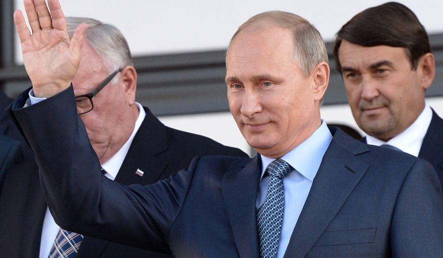 Russian President Vladimir Putin waves to people in the city of Gorno-Altaisk, Siberia, Russia on Thursday, Sept. 4, 2014. (AP Photo/RIA Novosti, Alexei Nikolsky, Presidential Press Service)