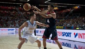 Stephen Curry of the US, right, shoots the ball in front of Ukraine's Dmytro during the Group C Basketball World Cup match, in Bilbao, northern Spain, Thursday, Sept. 4, 2014. The 2014 Basketball World Cup competition take place in various cities in Spain from Aug. 30 through to Sept. 14. (AP Photo/Alvaro Barrientos)