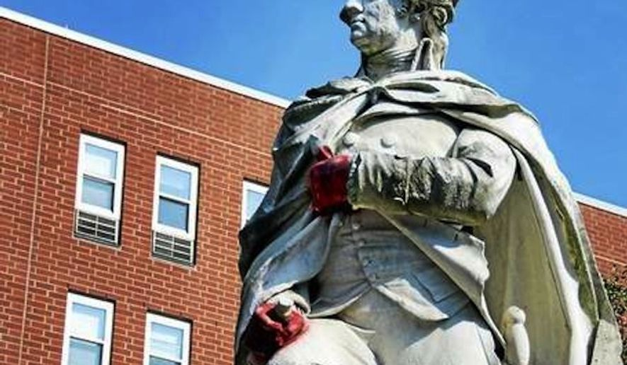 Police in Trenton, N.J., are searching for suspects responsible for painting George Washington's hands red on a 14-foot-statue over Labor Day weekend. (The Trentonian/Jackie Schear)