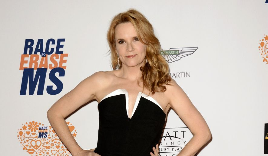 "FILE - In this May 2, 2014 file photo, actress Lea Thompson arrives at the 21st Annual Race to Erase MS Gala in Los Angeles. Thompson is one of 13 contestants on the new season of ""Dancing With the Stars,"" premiering Sept. 15, on ABC. (Photo by Dan Steinberg/Invision/AP, File)"