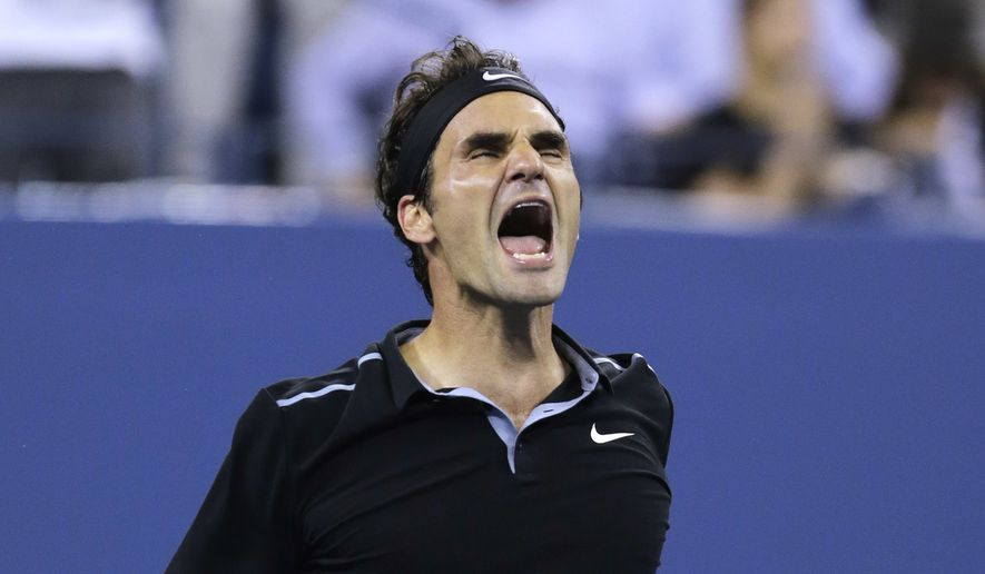 Roger Federer, of Switzerland, celebrates his win over Gael Monfils, of France, during the quarterfinals of the U.S. Open tennis tournament, Thursday, Sept. 4, 2014, in New York. Federer defeated Monfils 4-6, 3-6, 6-4, 7-5, 6-2. (AP Photo/Charles Krupa)