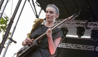 "In this June 19, 2014 file photo, St. Vincent seen at the 2014 Pitchfork Music Festival, in Chicago. St. Vincent, the stage name for singer-songwriter Annie Clark, continues a big year with a full autumn of touring, including a plum slot opening for the Black Keys. Her fourth album, ""St. Vincent,"" had her highest Billboard chart debut (No. 12), she played on ""Saturday Night Live"" and filled in for Kurt Cobain at Nirvana's Rock and Roll Hall of Fame induction. (Photo by Barry Brecheisen/Invision/AP, file)"