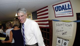 U.S. Sen. Mark Udall, D-Colo., greets supporters during appearance at a campaign headquarters in northwest Denver suburb of Wheat Ridge, Colo., on Friday, Sept. 5, 2014. (AP Photo/David Zalubowski)