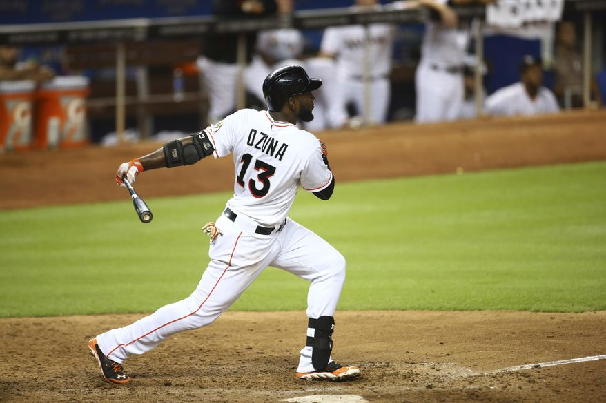 Miami Marlins' Marcell Ozuna hits a double during the eighth inning of a baseball game in Miami against the Atlanta Braves, Friday, Sept. 5, 2014. The Marlins won 11-3. (AP Photo/J Pat Carter)