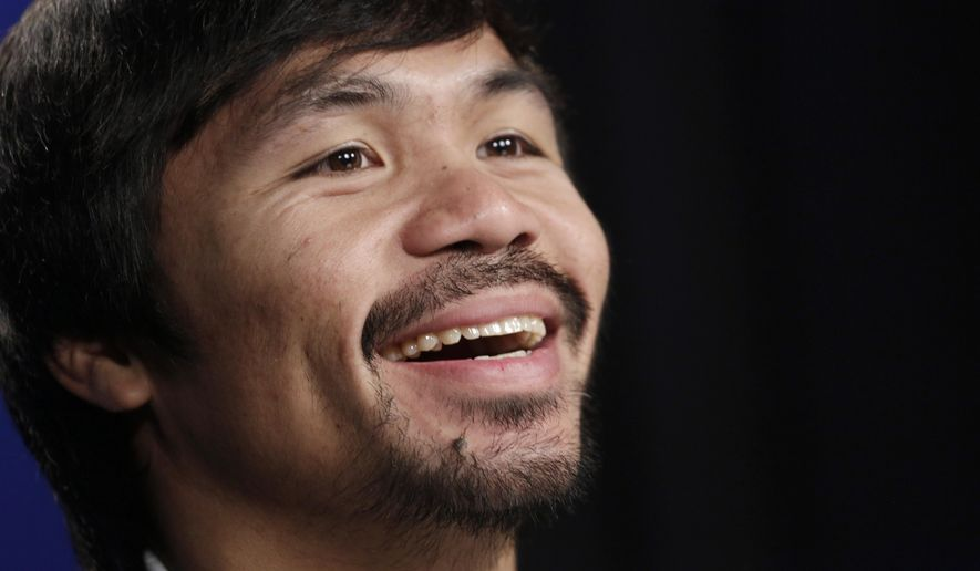 Boxer Manny Pacquiao participates in an interview with The Associated Press, Friday, Sept. 5, 2014 in New York. Pacquiao takes on undefeated Chris Algieri in the gambling enclave of Macau on Nov. 22 for a piece of the welterweight title. The bout comes a year after the Filipino headlined the first big fight card there by beating Brandon Rios. (AP Photo/Mark Lennihan)