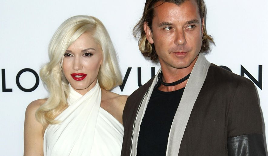 """FILE - In this June 4, 2013 file photo, Gavin Rossdale, right, and Gwen Stefani arrive at the LA premiere of """"The Bling Ring"""" in Los Angeles.  Stefani is a panelist on the singing competition series, """"The Voice."""" Rossdale was the """"coach"""" brought in to give advice to members of Stefani's team of aspiring singers, which starts its new season on Sept. 22. Rossdale was the lead singer of the British rock band Bush. (Photo by Matt Sayles/Invision/AP, File)"""