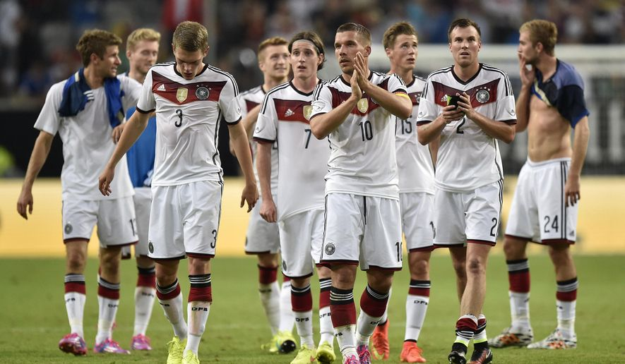 Germany players leave the pitch after losing 2-4 in the friendly soccer match between Germany and Argentina in Duesseldorf, Germany, Wednesday, Sept. 3, 2014. (AP Photo/Martin Meissner)