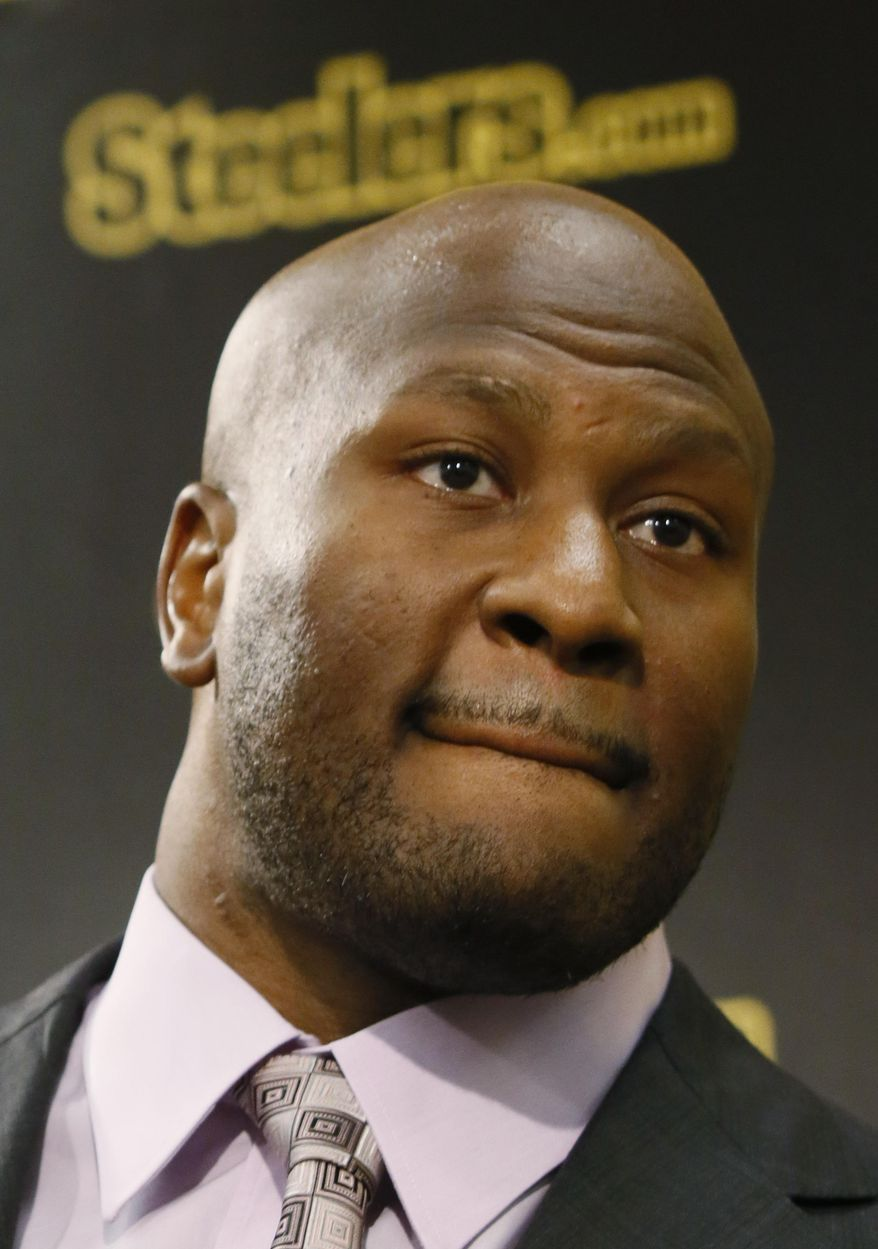 Former Pittsburgh Steelers linebacker James Harrison talks to reporters at a news conference where he talks about his retiring from football on Friday, Sept. 5, 2014 in Pittsburgh. Harrison, known for his hard hitting and a 100-yard interception return for a touchdown in Super Bowl XLIII, officially announced his retirement after 11 years in the NFL. (AP Photo/Keith Srakocic)