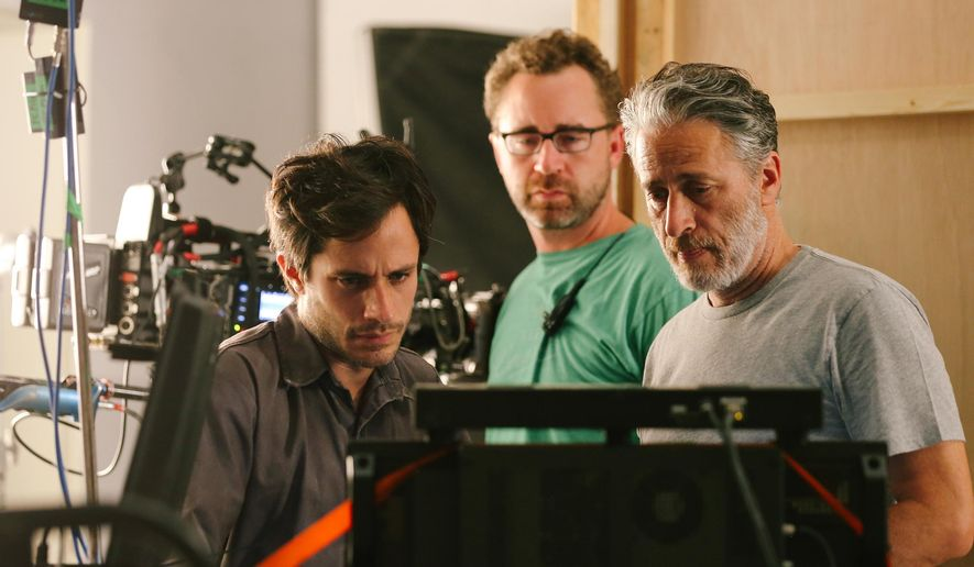 "This image released by Open Road Films shows from left, Gael Garcia Bernal, First Assistant Cameraman Michael Burke, and Jon Stewart on the set of ""Rosewater."" (AP Photo/Open Road Films, Laith Al-Majali)"