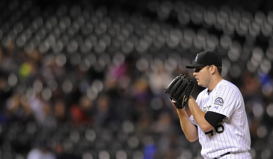 Colorado Rockies starting pitcher Tyler Matzek prepares to throw in the seventh inning of a baseball game against the San Diego Padres on Friday, Sept. 5, 2014, in Denver. (AP Photo/Chris Schneider)