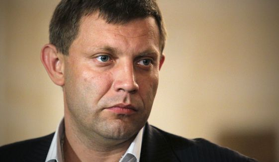Alexander Zakharchenko, the leader of pro-Russian rebels in Donetsk, meets with the media after talks on cease-fire in Ukraine in Minsk, Belarus, Friday, Sept. 5, 2014. Ukraine and the Russian-backed rebels have signed a cease-fire deal that starts in less than two hours, a European official at the talks said Friday. (AP Photo)