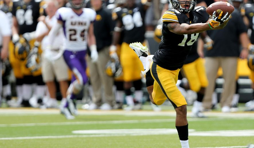 Iowa wide receiver Derrick Willies catches a pass during the second half of an NCAA college football game against Northern Iowa, Saturday, Aug. 30, 2014, in Iowa City, Iowa. (AP Photo/Justin Hayworth)