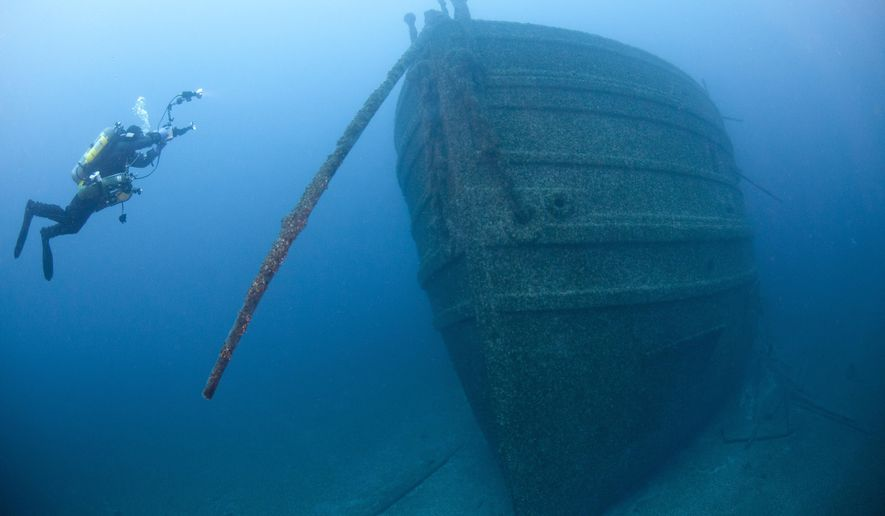 In this May 22, 2011 photo released by the Thunder Bay National Marine Sanctuary, a diver is shown at the Florida wreckage in the expanded boundary waters of Lake Huron near Alpena, Mich. The Thunder Bay National Marine Sanctuary in Michigan has received federal approval to expand its size nearly tenfold and boost preservation of scores of additional shipwrecks in Lake Huron. The only national sanctuary in fresh water announced Friday, Sept. 5, 2014 that the Obama administration approved the years-in-the-making effort to extend it from about 450 square miles to 4,300 square miles. The expansion, which incorporates the waters off Alcona, Alpena and Presque Isle counties in Michigan and to the international border with Canada, also doubles the number of estimated shipwrecks to about 200.  (AP Photo/Thunder Bay National Marine Sanctuary)