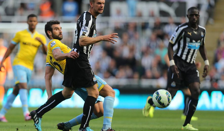 Newcastle United's Siem De Jong, right, vies for the ball with Crystal Palace's captain Mile Jedinak, left, during their English Premier League soccer match at St James' Park, Newcastle, England, Saturday, Aug. 30, 2014. (AP Photo/Scott Heppell)