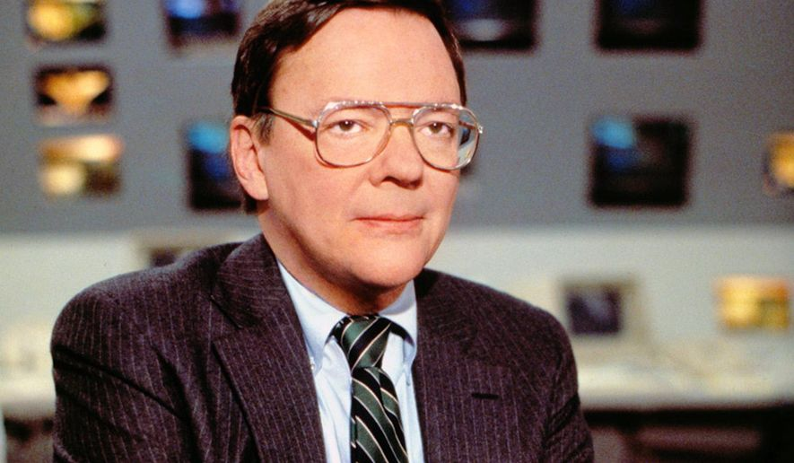 In this June 28, 1988 photo released by CBS, CBS News correspondent Bruce Morton poses on the set of the CBS news room in New York. Morton, an award-winning political correspondent for CBS News who also covered the Vietnam War and the space program, died Friday, Sept. 5, 2014, at his home in Washington, D.C., after a battle with cancer. He was 83.  (AP Photo/CBS)