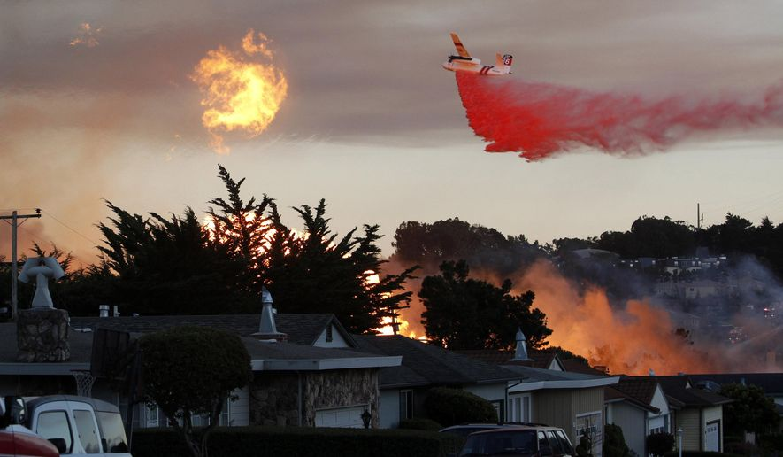 FILE - In this Sept. 9, 2010, file photo, a massive fire following a pipeline explosion roars through a mostly residential neighborhood in San Bruno, Calif. A proposed utility fine that would create a nearly $1 billion windfall for the state of California has set up a regulatory tussle over how the state punishes corporate wrongdoing and who should benefit from the record-sized penalty. (AP Photo/Jeff Chiu, File)