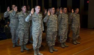 Airmen take the Oath of Enlistment during a reenlistment ceremony in December, 2013. (U.S. Air Force)
