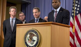 **FILE** Acting Associate Attorney General Tony West (right) speaks as New York Attorney General Eric Schneiderman (second from right), Stuart F. Delery (second from left), Acting Assistant Attorney General for the Civil Division, and Housing and Urban Development Secretary Shaun Donovan stand by during a news conference at the Department of Justice in Washington on Oct. 2, 2012, about the first legal action of the Residential Mortgage-Backed Securities (RMBS) Working Group. (Associated Press)