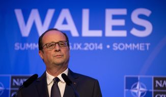 French President Francois Hollande speaks during a press conference at the end of the NATO summit at the Celtic Manor Resort in Newport, Wales, Friday, Sept. 5, 2014.   (AP Photo/Matt Dunham)