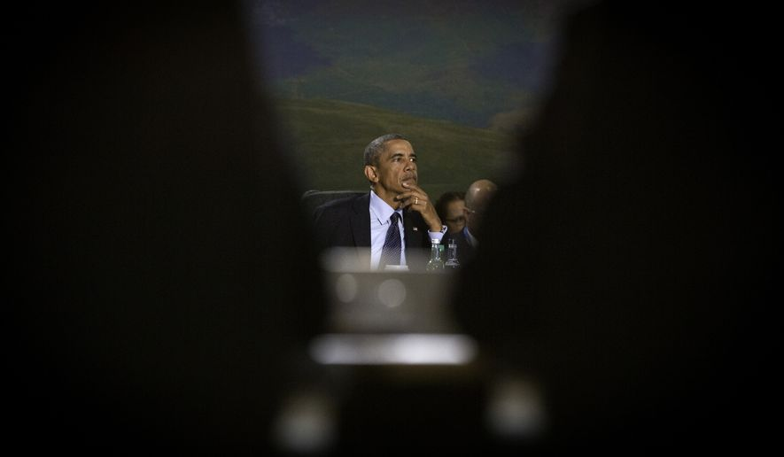 U.S. President Barack Obama listens to the opening comments during a round table meeting of the North Atlantic Council during a NATO summit at the Celtic Manor Resort in Newport, Wales on Friday, Sept. 5, 2014. (AP Photo/Virginia Mayo)