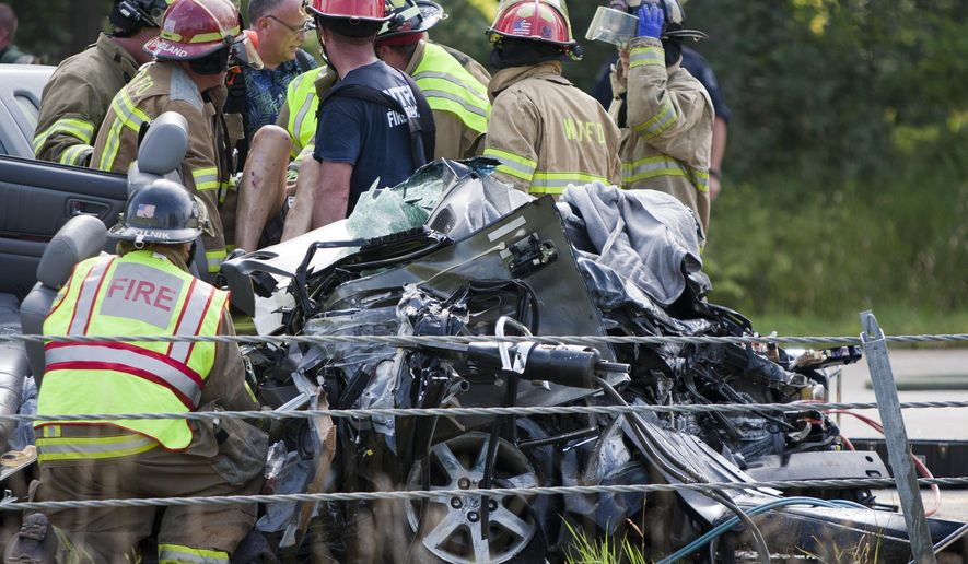 Rescue workers respond to a wrong-way head-on crash on eastbound I-96, near Exit 23, in Marne, Mich.,  Friday, Sept. 5, 2014. A Grand Rapids woman was killed and three other people critically injured in a wrong-way crash on Interstate 96 in Ottawa County. (AP Photo/The Grand Rapids Press, Cory Morse)