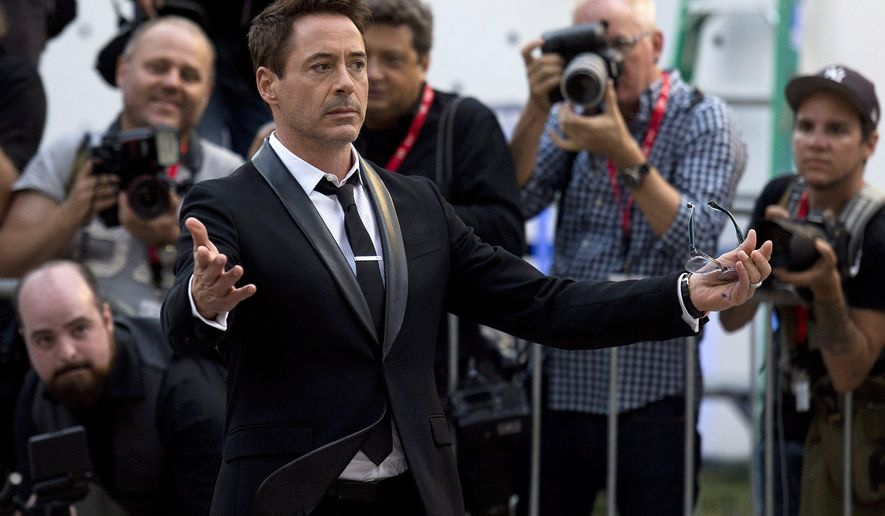 """Actor Robert Downey Jr. arrives for the premiere of his film, """"The Judge"""" during the 2014 Toronto International Film Festival in Toronto on Thursday, Sept. 4, 2014. (AP Photo/The Canadian Press, Nathan Denette)"""
