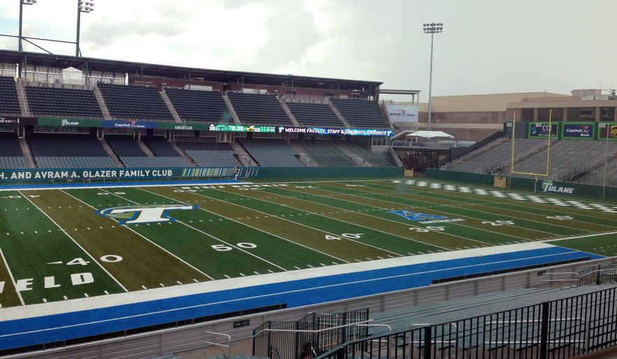 In this photo taken Thursday, Sept. 4, 2014, recently completed Yulman Stadium is viewed in New Orleans, La. The stadium will bring back NCAA college football to Tulane's campus for the first time since 1974 on Saturday with a game against Georgia Tech. (AP Photo/Brett Marrtel)
