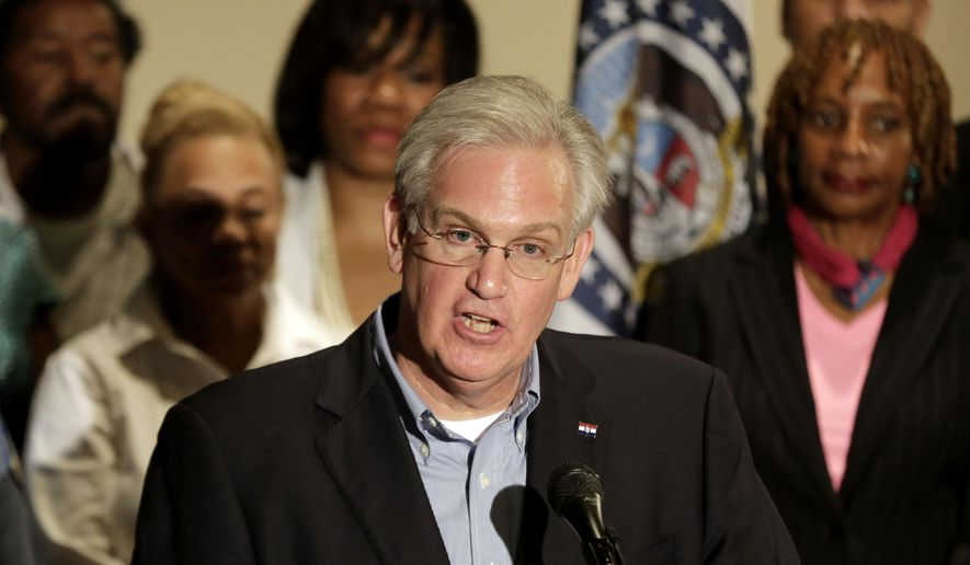 In this Aug. 16, 2014, file photo Missouri Gov. Jay Nixon speaks at a news conference in Ferguson, Mo., dealing with the aftermath of the police shooting of Michael Brown. (AP Photo/Charlie Riedel, File)