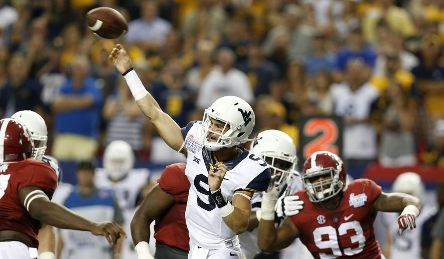 West Virginia quarterback Clint Trickett (9 throws a pass against Alabama in the first half of an NCAA college football game Saturday, Aug. 30, 2014, in Atlanta.  (AP Photo/Brynn Anderson)