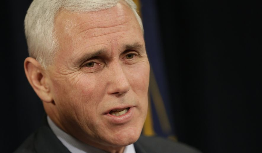 In this file photo taken on Monday, Dec. 16, 2013, Indiana Gov. Mike Pence, talks to the media after naming Rep. Suzanne Crouch R-Evansville, Indiana State Auditor at the Statehouse in Indianapolis. Pence is angering the hardcore conservatives who courted him for the White House in 2012 as he positions himself for a possible presidential run in 2016. (AP Photo/AJ Mast)