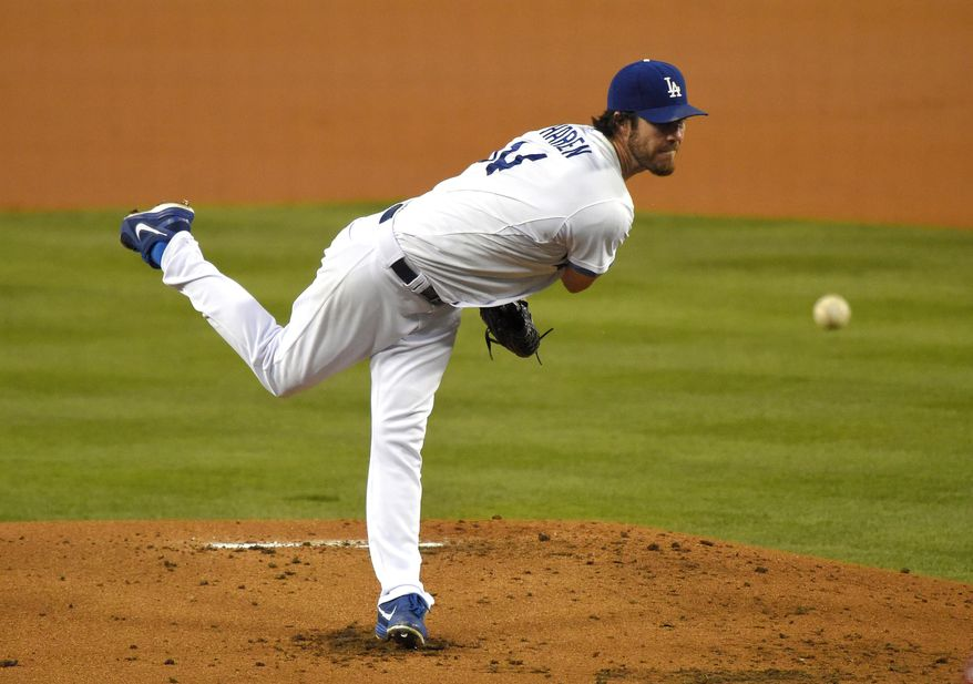 Los Angeles Dodgers starting pitcher Dan Haren throws to the plate during the first inning of a baseball game against the Arizona Diamondbacks, Friday, Sept. 5, 2014, in Los Angeles. (AP Photo/Mark J. Terrill)