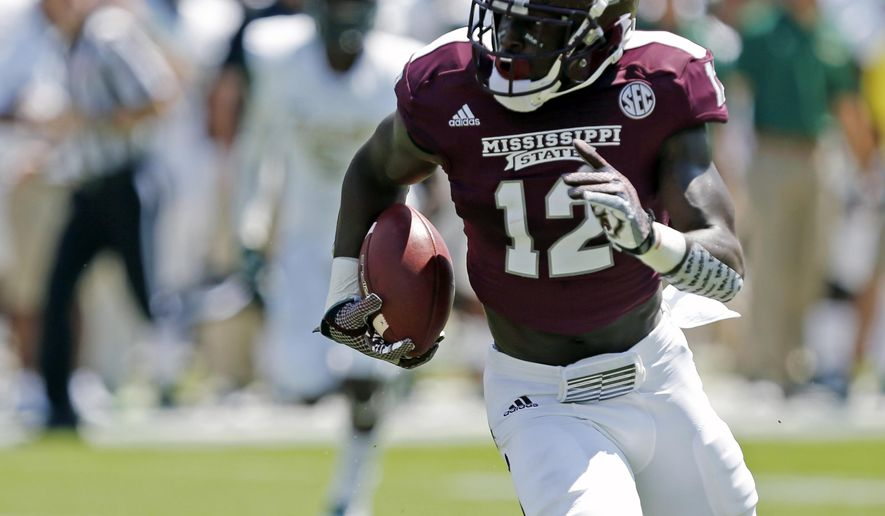 Mississippi State wide receiver Robert Johnson (12) runs up field on his way to a 68-yard touchdown pass reception against UAB in the first half of an NCAA college football game in Starkville, Miss., Saturday, Sept. 6, 2014.  (AP Photo/Rogelio V. Solis)