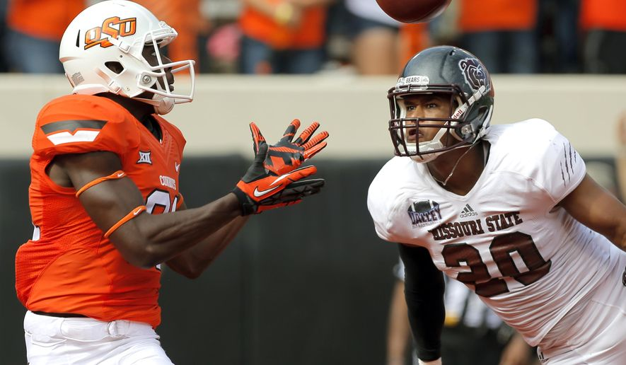 Oklahoma State's Jhajuan Seales (81) catches a touchdown pass after it was tipped by Missouri State's Mike Crutcher (20) during a college football game between the Oklahoma State University Cowboys (OSU) and the Missouri State Bears (MSU) at Boone Pickens Stadium in Stillwater, Okla., Saturday, Sept. 6, 2014. (AP Photo/The Oklahoman, Sarah Phipps)