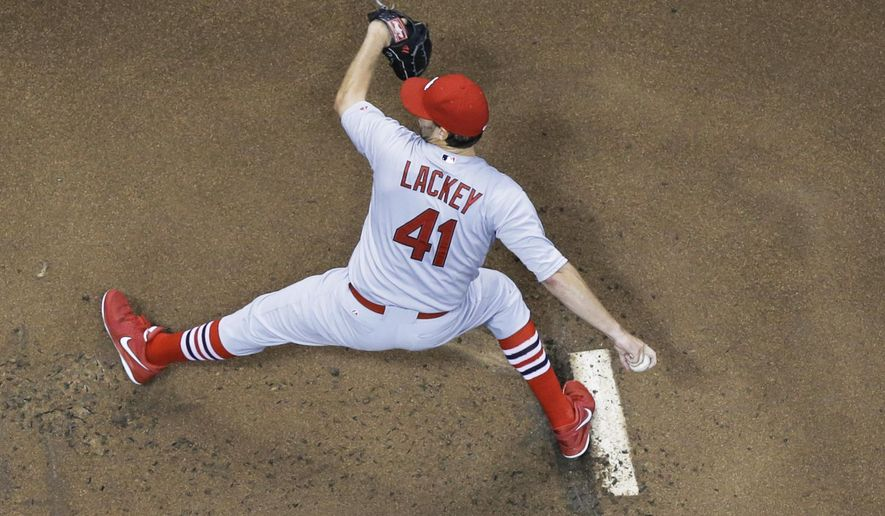 St. Louis Cardinals starting pitcher John Lackey throws during the first inning of a baseball game against the Milwaukee Brewers on Friday, Sept. 5, 2014, in Milwaukee. (AP Photo/Morry Gash)