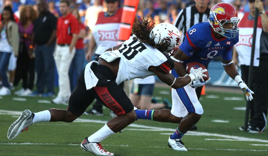Kansas' Nick Harwell (8) runs past Southeast Missouri St. cornerback Justin Elias for a touchdown during the first quarter of an NCAA football game Saturday, Sept. 6, 2014, in Lawrence, Kan. (AP Photo/Ed Zurga)