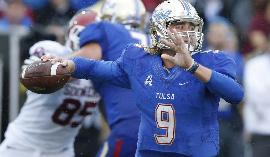 Tulsa quarterback Dane Evans (9) passes against Oklahoma in the second quarter of an NCAA college football game in Tulsa, Okla., Saturday, Sept. 6, 2014. (AP Photo/Sue Ogrocki)