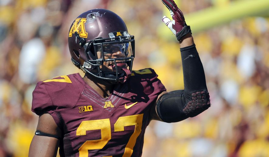 Minnesota running back David Cobb waves to the crowd after scoring a touchdown against Middle Tennessee during the first half of an NCAA college football game on Saturday, Sept. 6, 2014, in Minneapolis. (AP Photo/Craig Lassig)