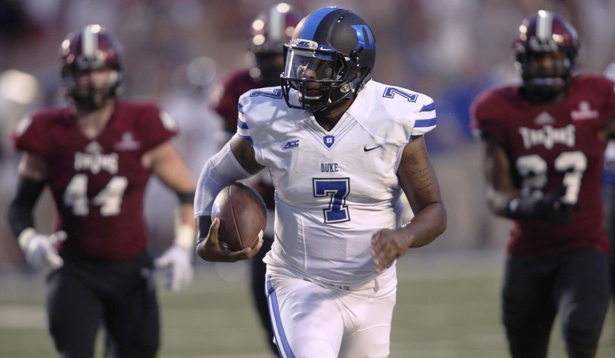 Duke quarterback Anthony Boone (7) runs for a touchdown past Troy defensive end Tyler Roberts (44) and linebacker Wayland Coleman-Dancer (23) in the first half of an NCAA college football game at Veterans Memorial Stadium, Saturday, Sept. 6, 2014, in Troy, Ala. (AP Photo/ Hal Yeager)