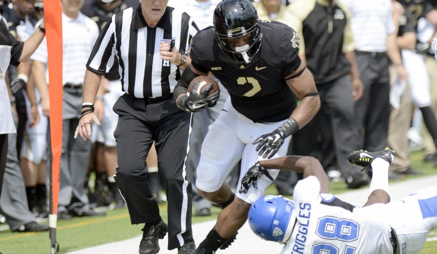 Army tight end Kelvin White (2) is defended by Buffalo defensive back Dwellie Striggles (28) during the first half of an NCAA college football game Saturday, Sept. 6, 2014, in West Point, N.Y. (AP Photo/Hans Pennink)