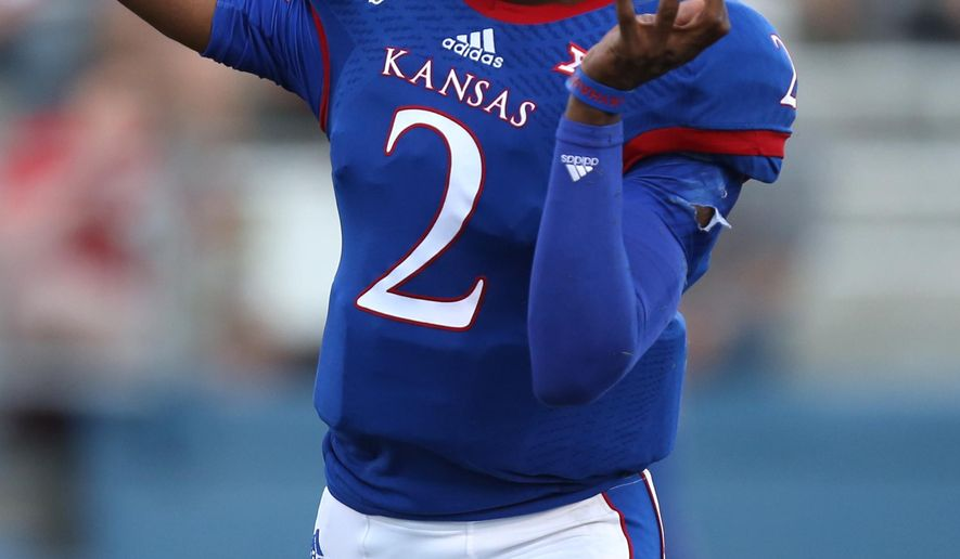 Kansas quarterback Montell Cozart drops back for a pass during the second quarter of an NCAA football game against Southeast Missouri State Saturday, Sept. 6, 2014, in Lawrence, Kan. (AP Photo/Ed Zurga)